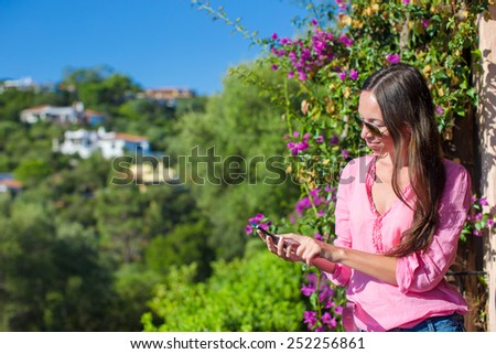Young beautiful woman talking with her cellphone outdoors - stock photo