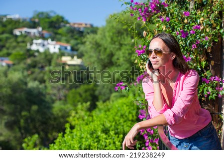 Young beautiful woman talking with her phone - stock photo