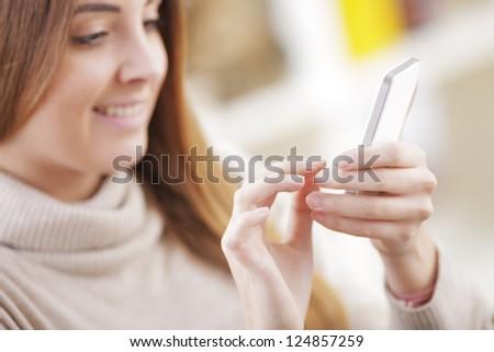 Young beautiful woman text messaging - stock photo