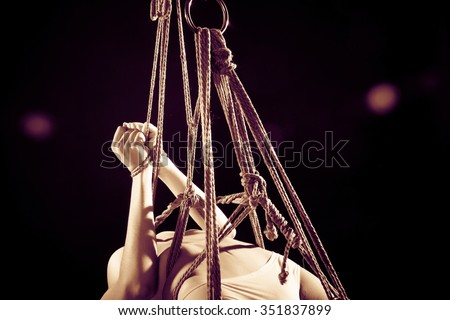 young beautiful woman tied up with rope