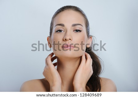 Young beautiful woman touching and massaging her neck - stock photo