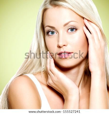 Young beautiful  woman touching her fresh  face  - stock photo