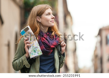 Young beautiful woman travel with map. - stock photo