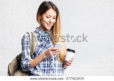 Young beautiful woman using smart phone - stock photo