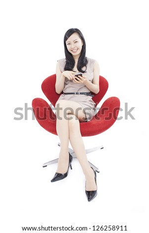 young beautiful woman using smart phone, isolated on white background - stock photo