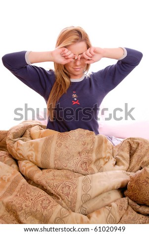 Young beautiful woman waking up in the morning - stock photo