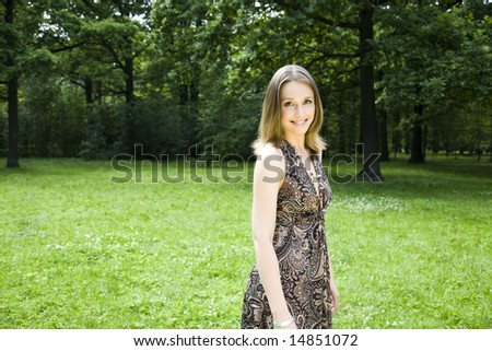 Young Beautiful Woman Walking On The Park