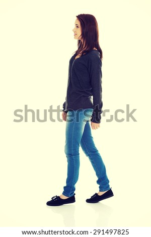 Young beautiful woman walking smiling