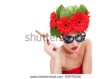young beautiful woman wearing a gerbera wreath and sunglasses, smoking on a white background