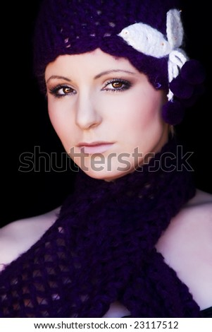 Young beautiful woman wearing just a few winter complements. - stock photo