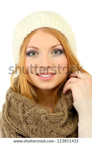 Young beautiful woman wearing winter clothing, isolated on white