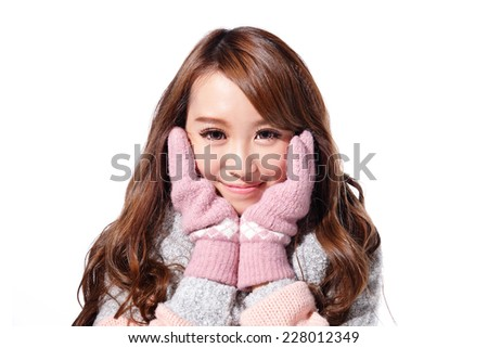 Young beautiful woman wearing winter clothing isolated on white background, asian beauty - stock photo