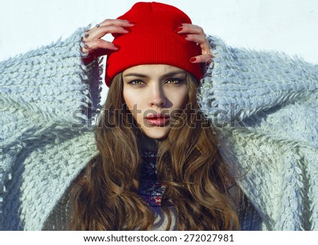 Young beautiful woman winter portrait. Red hat. Hipster lifestyle. - stock photo