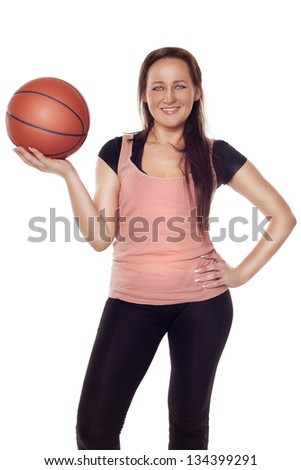 Young beautiful woman with a ball over isolated background - stock photo