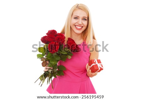 Young beautiful woman with a bouquet of roses. - stock photo