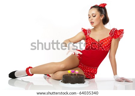 Young beautiful woman with a cake. Close-up studio portrait.
