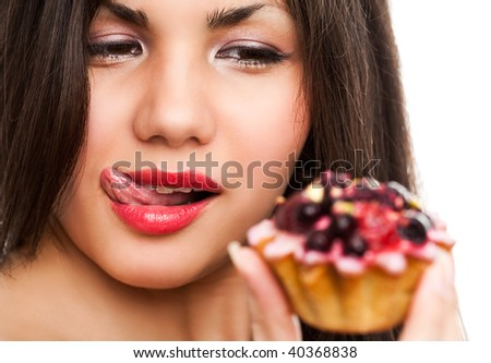 Young beautiful woman with a cake. Close-up studio portrait. isolated on white - stock photo