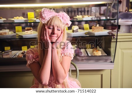 Young beautiful woman with a cakes. - stock photo