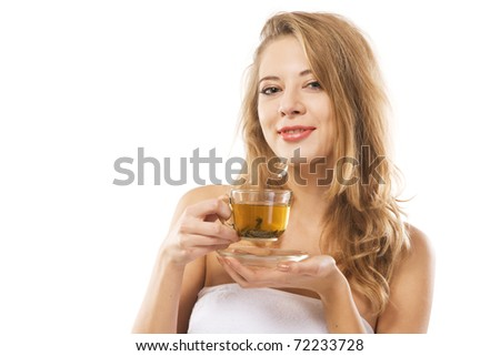 Young beautiful woman with a cup of green tea against white background - stock photo