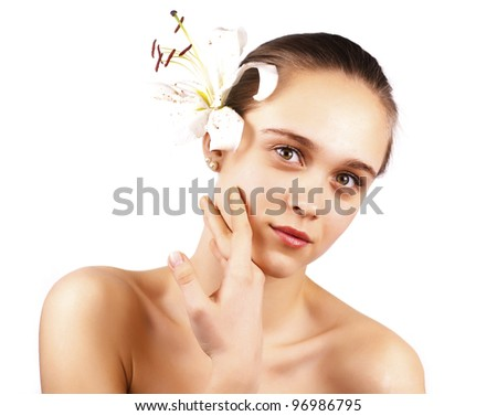 young beautiful woman with a flower isolated on a white background - stock photo