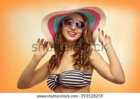 Young beautiful woman with a hat in the hot summer