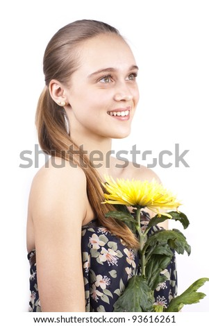 young beautiful woman with a yellow flower isolated on a white background - stock photo