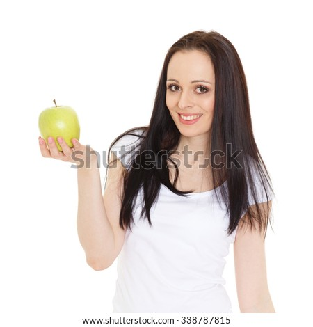 Young beautiful woman with an apple stands on a white background. Concept of healthy food. - stock photo