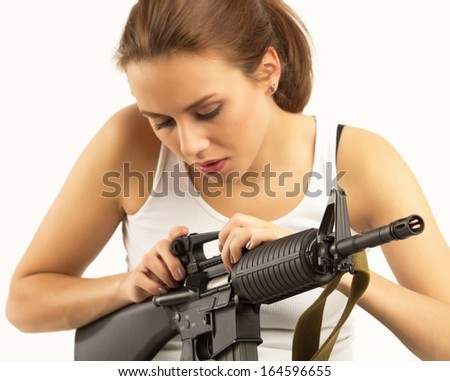 Young beautiful woman with an M-16 rifle - stock photo