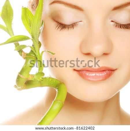 young beautiful woman with bamboo - stock photo