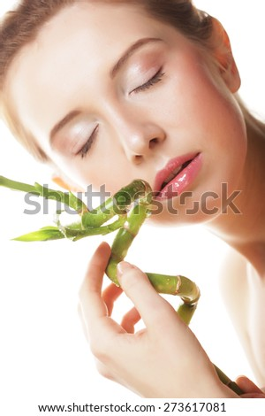 young beautiful woman with bamboo isolated on white. - stock photo