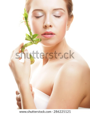 young beautiful woman with bamboo isolated on white - stock photo