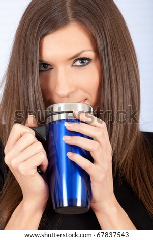 young beautiful woman with big blue cup - stock photo