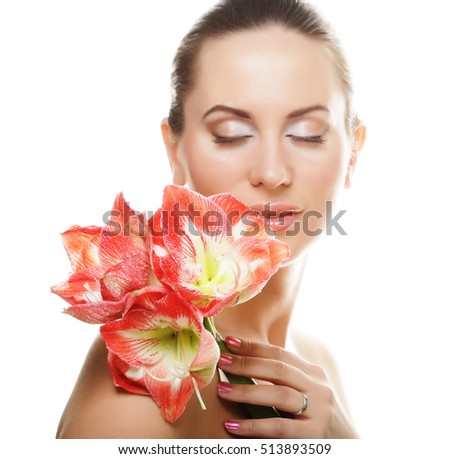 young beautiful woman with big pink flowers
