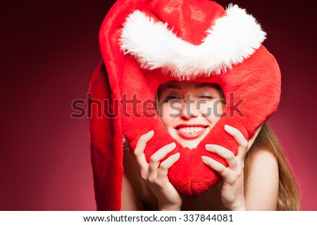 young beautiful woman with big red heart - stock photo