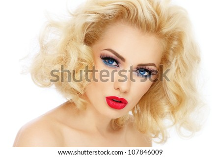 Young beautiful woman with blond curly hair and stylish make-up, over white background - stock photo