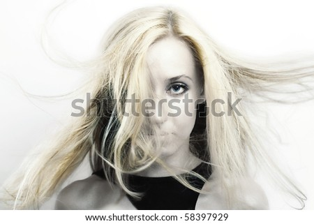 Young beautiful woman with blonde hair  flutter in the wind close up