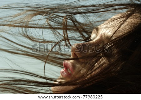 Young beautiful woman with blue sky in the background - stock photo