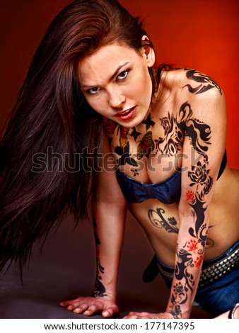 Young beautiful woman with body art .