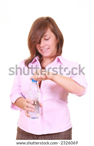 young beautiful woman with bottle of mineral water isolated on white - stock photo