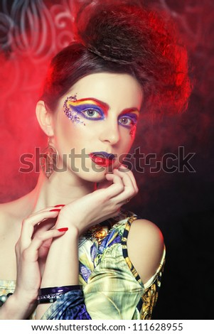 Young beautiful woman with bright make up - stock photo
