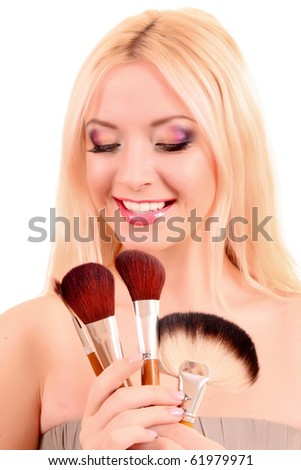 Young beautiful woman with brushes for make-up isolated on white