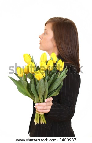 young beautiful woman with bunch of tulips isolated on white - stock photo