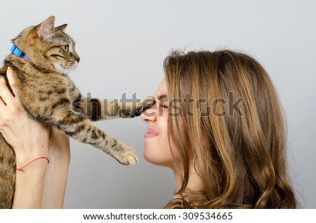 young beautiful woman with cat - stock photo