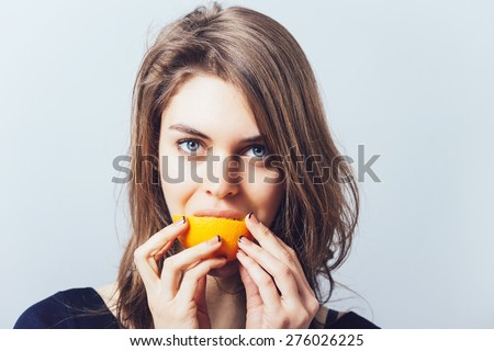 young beautiful woman with citrus orange fruit having fun.  - stock photo