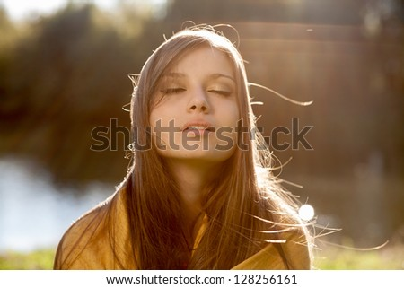 young beautiful woman with closed eyes - stock photo