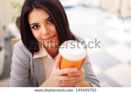 Young beautiful woman with coffee - stock photo