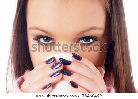 Young beautiful woman with coffee cup during break - stock photo