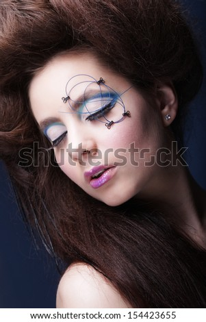 young beautiful woman with creative haircut and bright visage