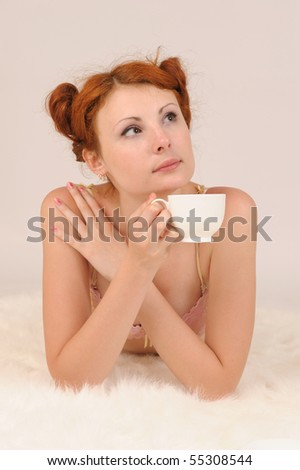 young beautiful woman with cup of tea - stock photo