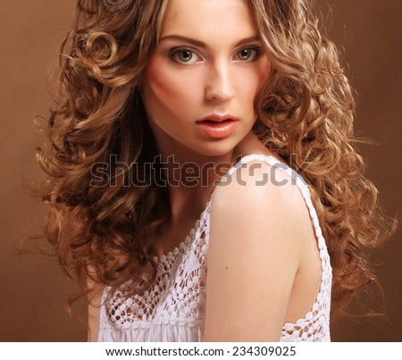 young beautiful woman with curly hair - stock photo